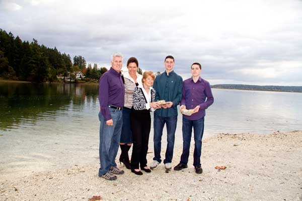 Minterbrook Oyster Farm owners (from left) Kent Kingman, Donna Kingman, and sons Austin and Garrett Kingman pose with former owner Beverly Wiksten. The Kingman family will soon be opening an oyster bar in Purdy.